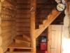 Лестница внутри дома из сруба